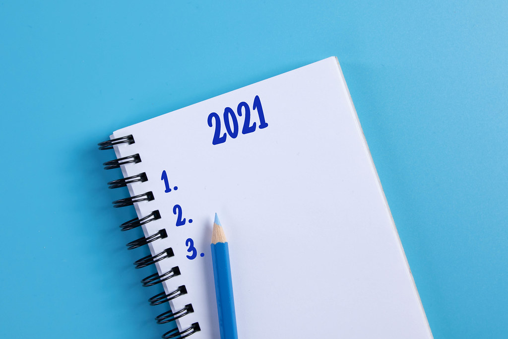 Notebook with 2021 List to do on blue background