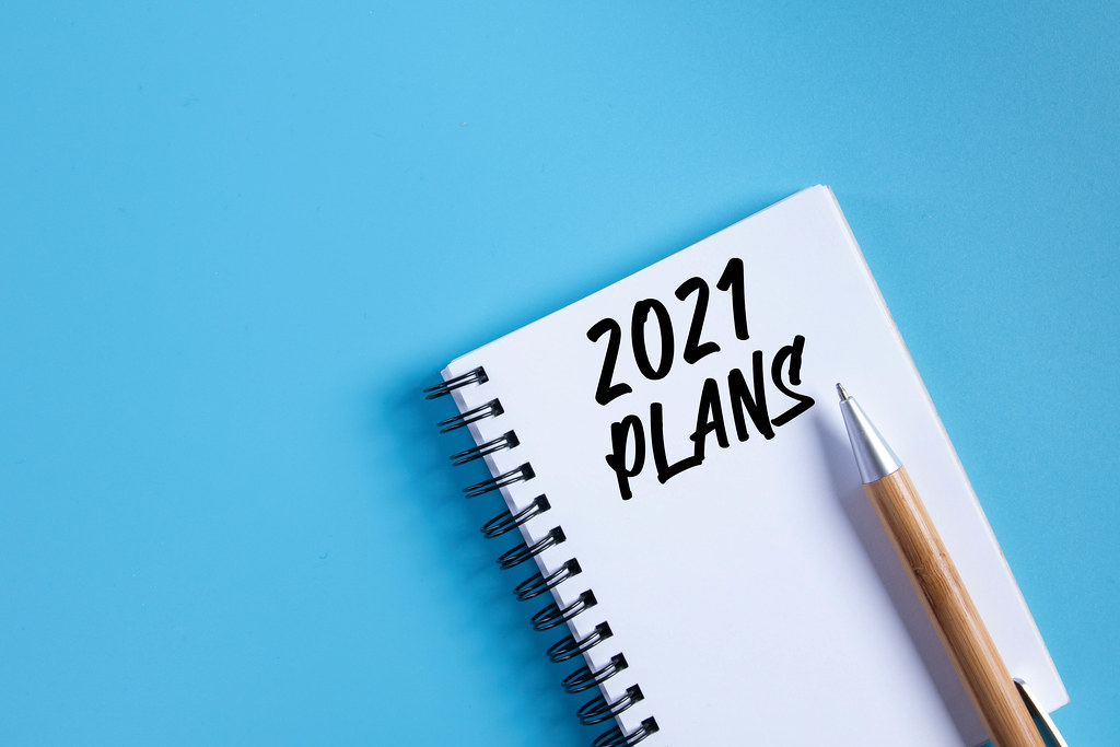 Notebook with 2021 Plans text on blue background