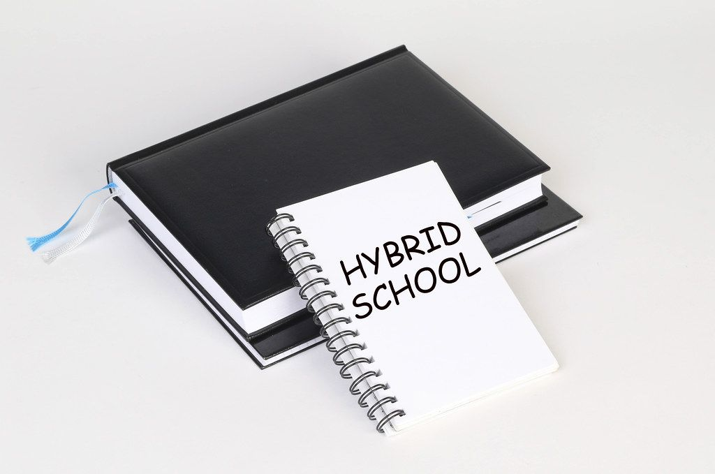 Notebook with Hybrid School text
