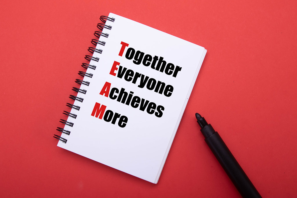 Notebook with Together Everyone Achieves More text
