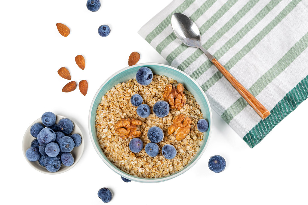 Oat flakes with nuts and blueberries, top view