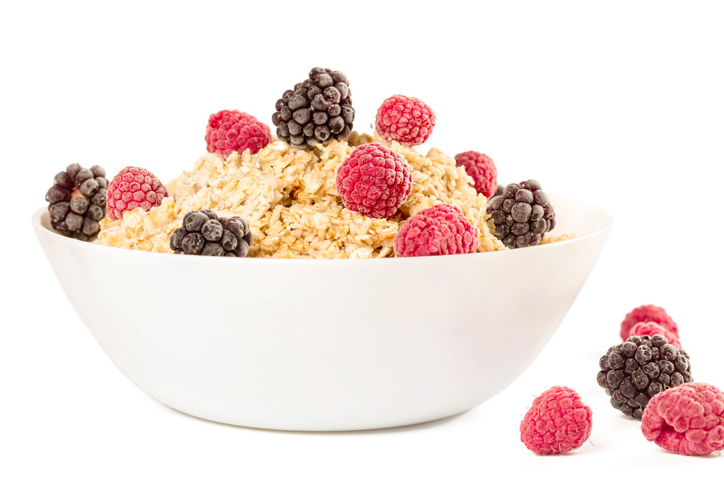 Oatmeal for breakfast with raspberries and blackberries