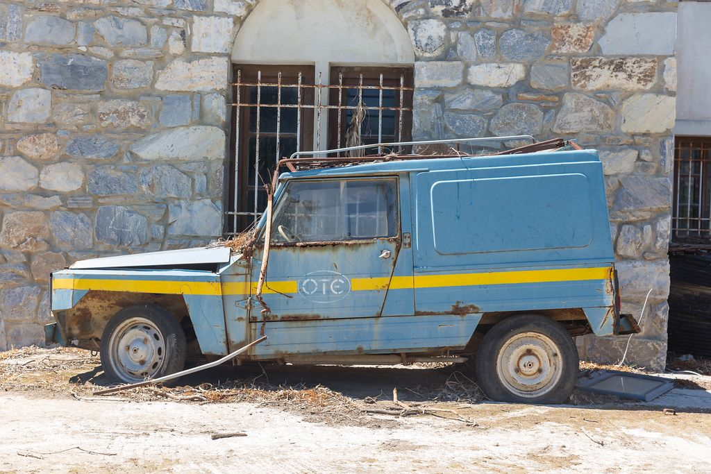 Old blue-yellow van parked in the village of Chalkio in the interior of Naxos, Greece