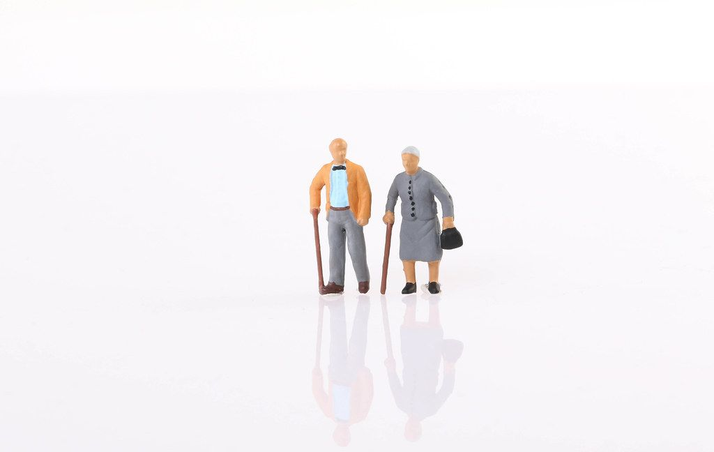 Old couple on white background