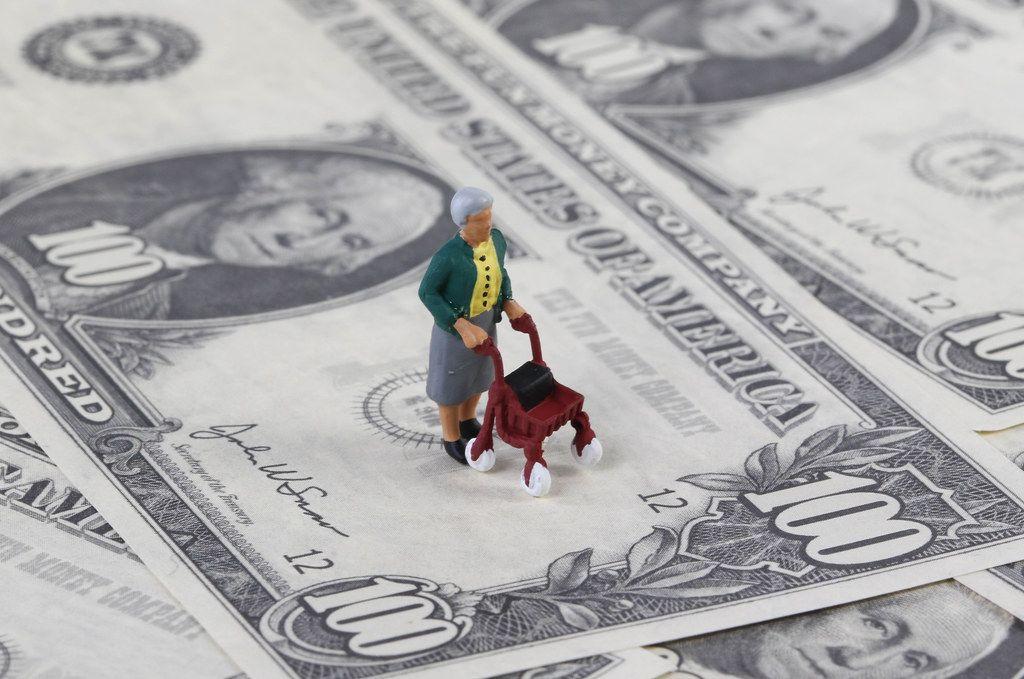 Old miniature women on dollar banknotes