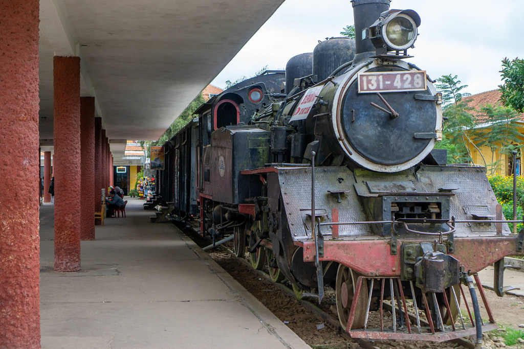 Old Steam Engine Locomotive with Waggons parking at the Dalat Railway Station as a Tourist Attraction in Da Lat, Vietnam