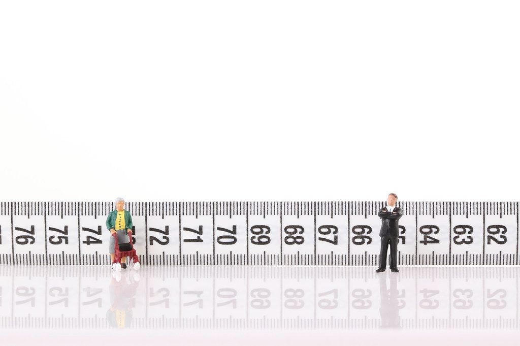 Old women and businessman with measure tape on white background