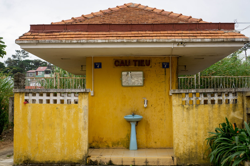 Old Yellow Toilet Building from French Colonial Time at the Dalat Railway Station in Da Lat, Vietnam