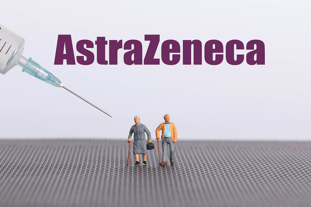 Older couple with syringe and AstraZeneca text