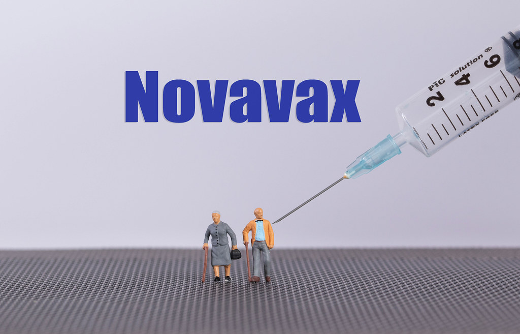 Older couple with syringe and Novavax text