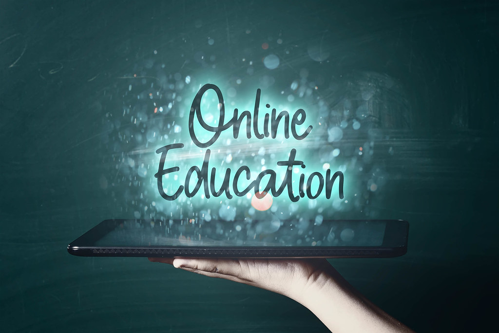 Online education concept - a person with tablet