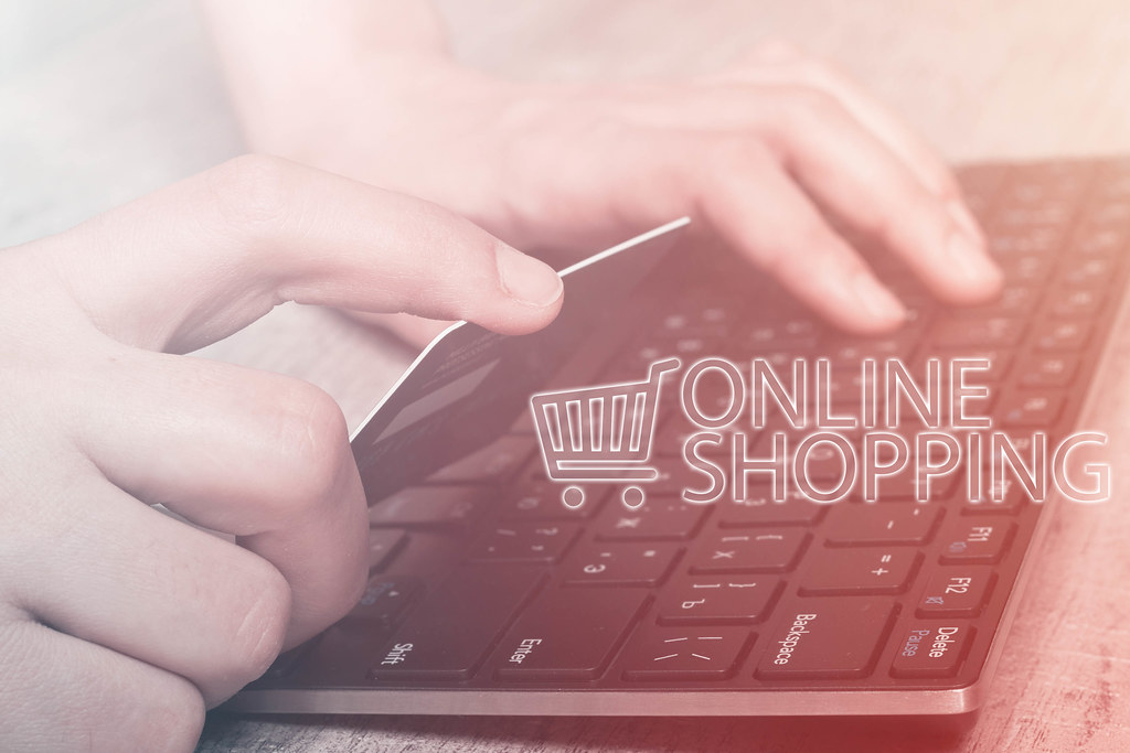 Online shopping - Hands holding credit card and using laptop