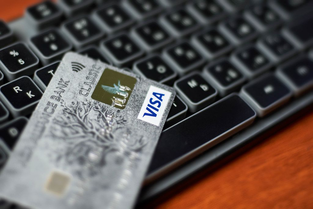 Online shopping. Visa credit card on keyboard