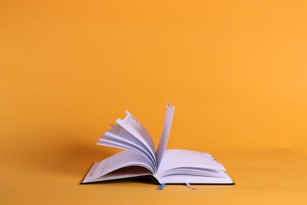 Open book on orange background