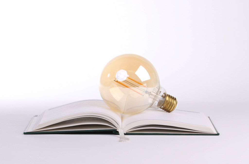 Open book with a lightbulb