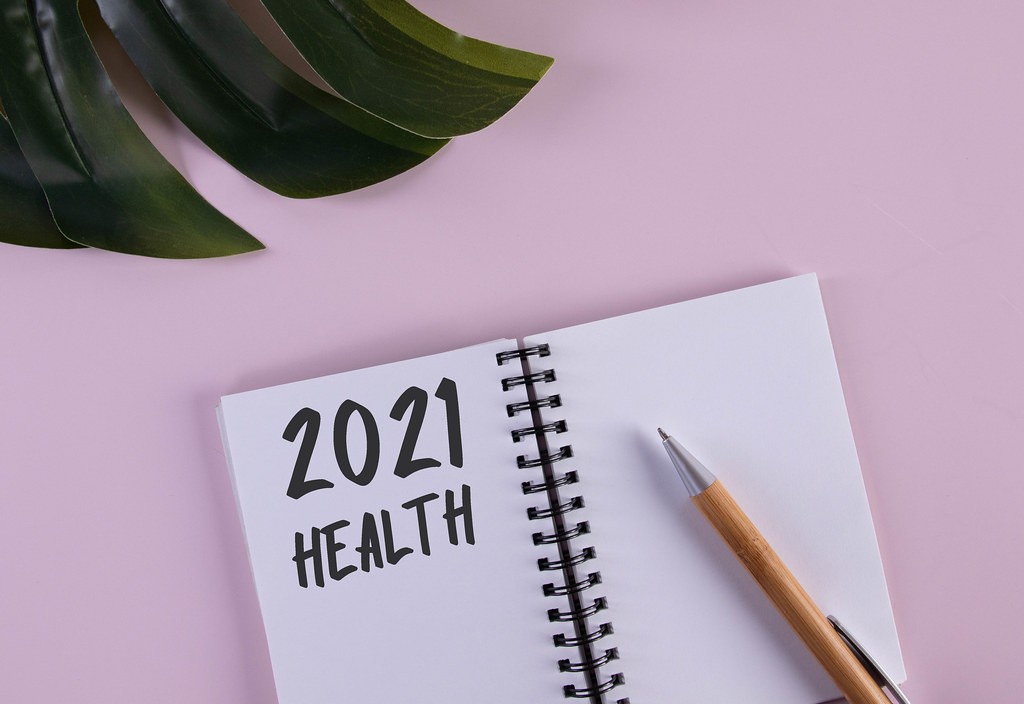 Open notebook with 2021 Health text