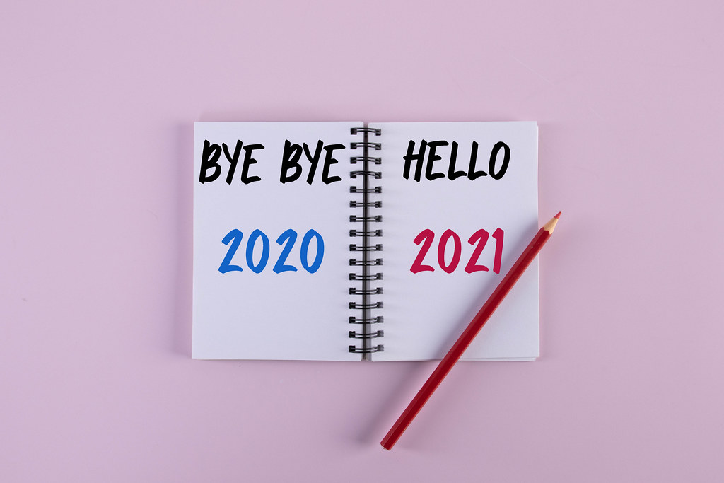 Open notebook with Bye bye 2020 Hello 2021 text