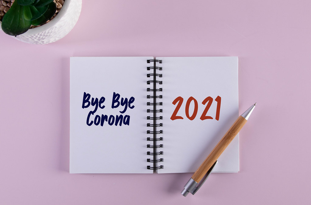 Open notebook with Bye Bye Corona 2021 text