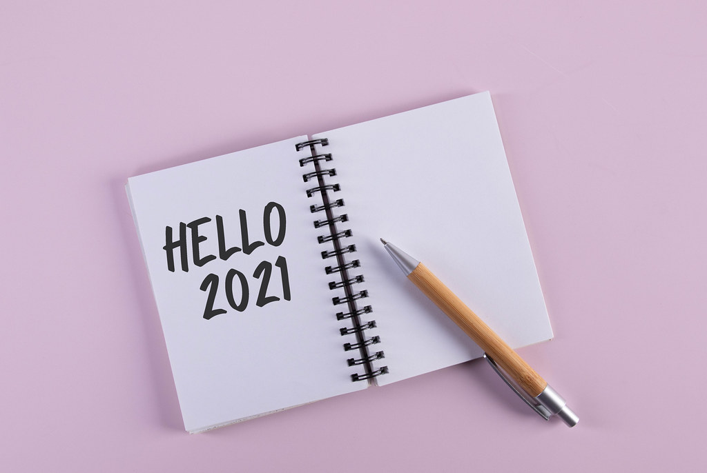 Open notebook with Hello 2021 text