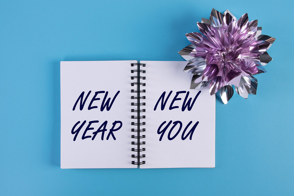 Open notebook with New Year New You text on blue background