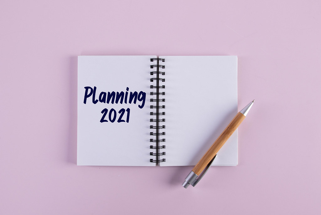 Open notebook with pen and Planning 2021 text