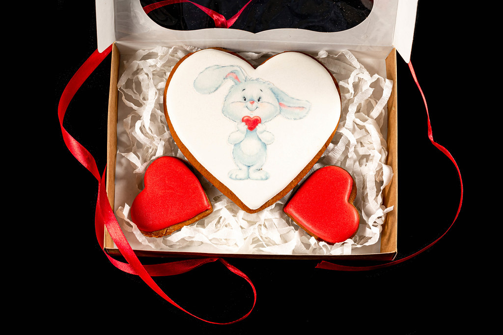 Open valentine's day gift box with gingerbread hearts