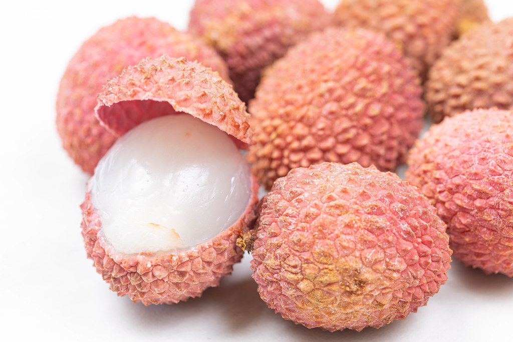 Opened Lychee fruit on the plate