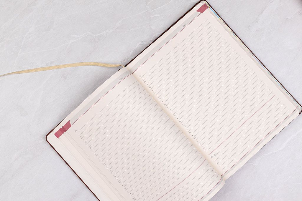 Opened Paper Notebook with Business concept and copy space