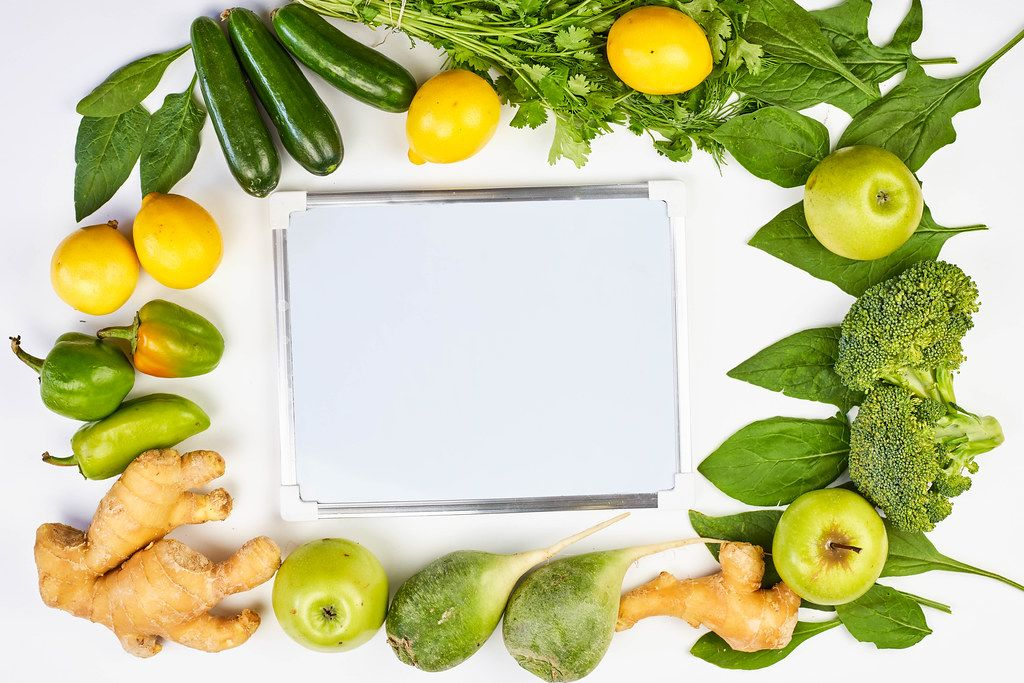Organic detox fruits and vegetables with whiteboard
