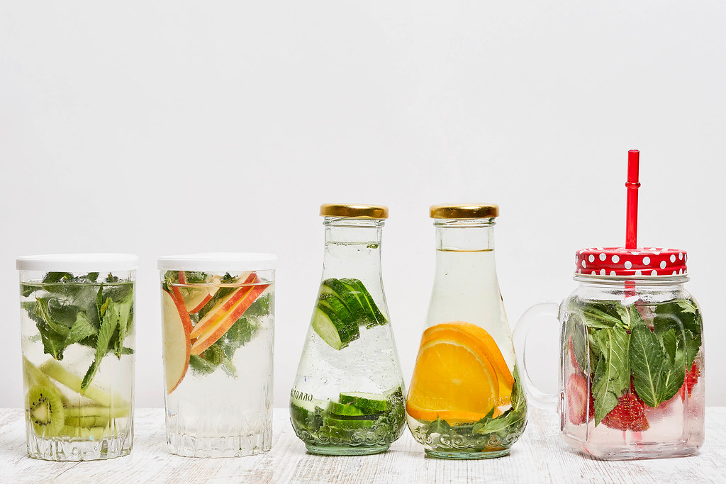 Organic summer cold refreshing drinks - detox infused water with fruits and vegetables