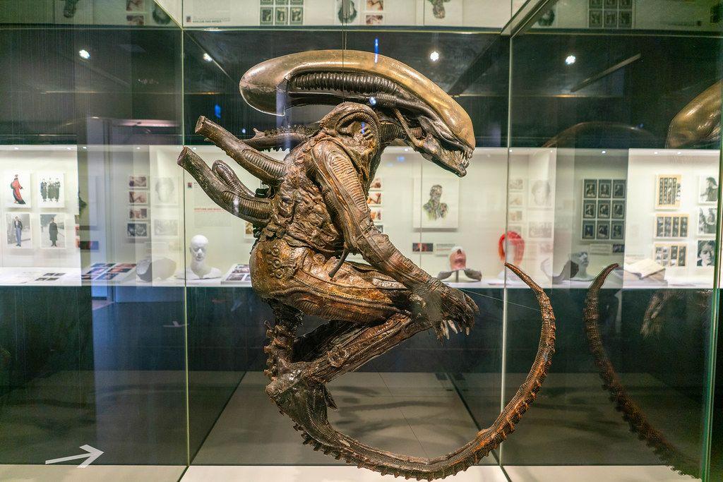 Original Alien film costume suspended in a museum