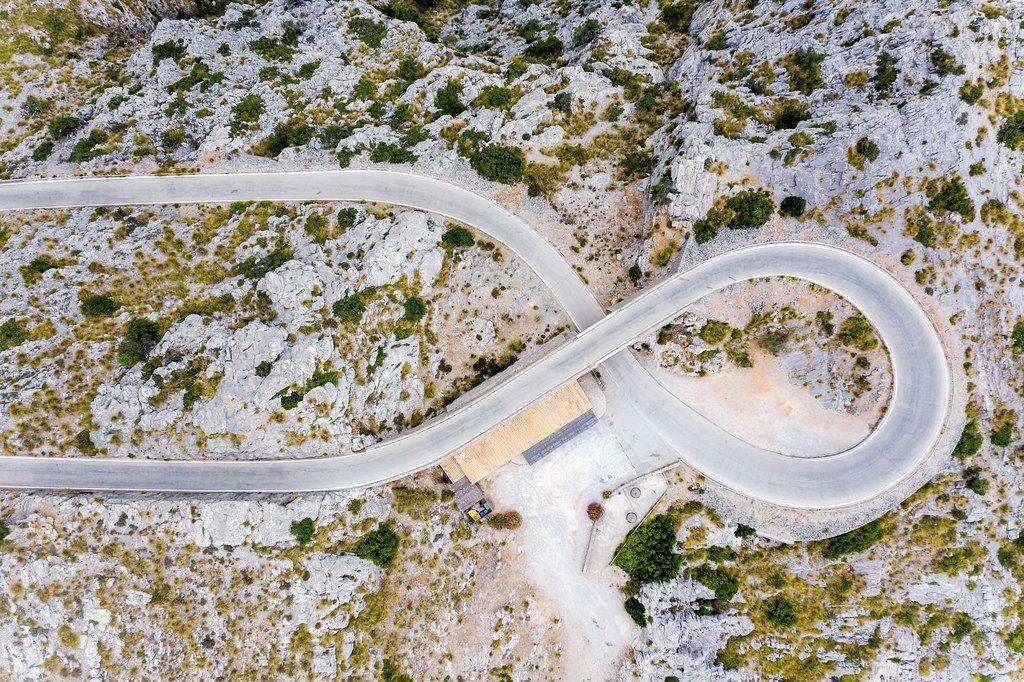 Overhead drone pic of world-famous road curve: Nus de sa Corbata (
