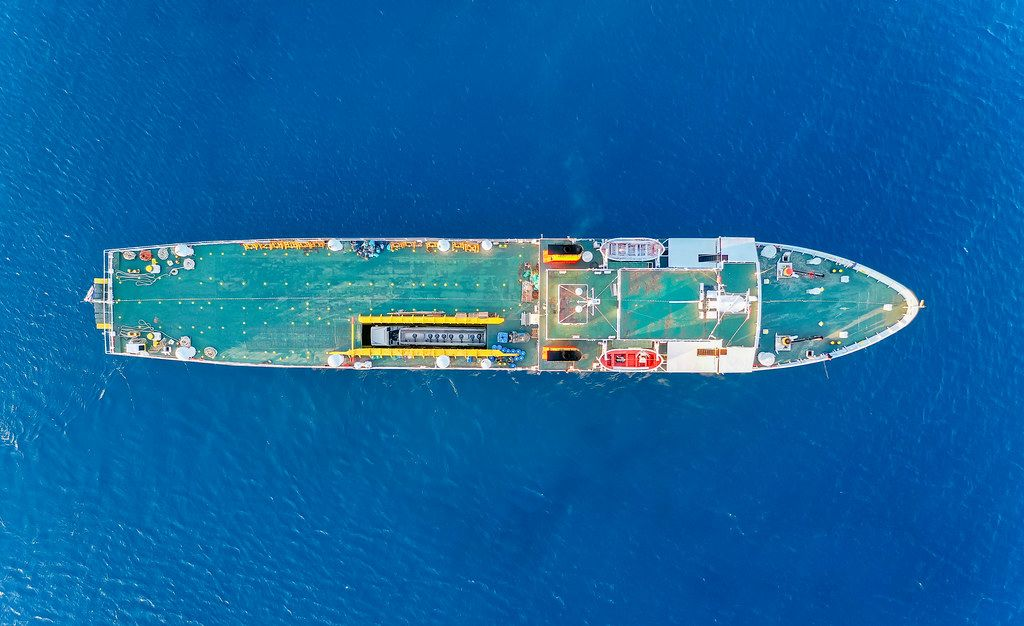 Overhead drone shot of the Greek cargo ship Kapetan Christos with its blue deck