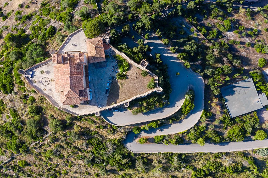 Overhead drone shot of the medieval fortress in Artà, Mallorca. Santuari de Sant Salvador with snake road