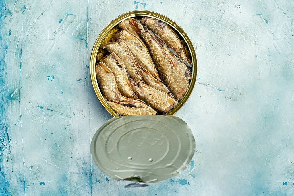 Overhead view of smoked sprats in can
