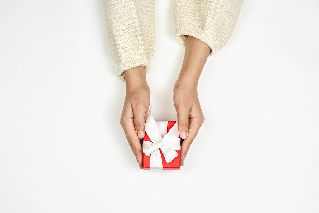 Overhead view of woman holding Christmas gift