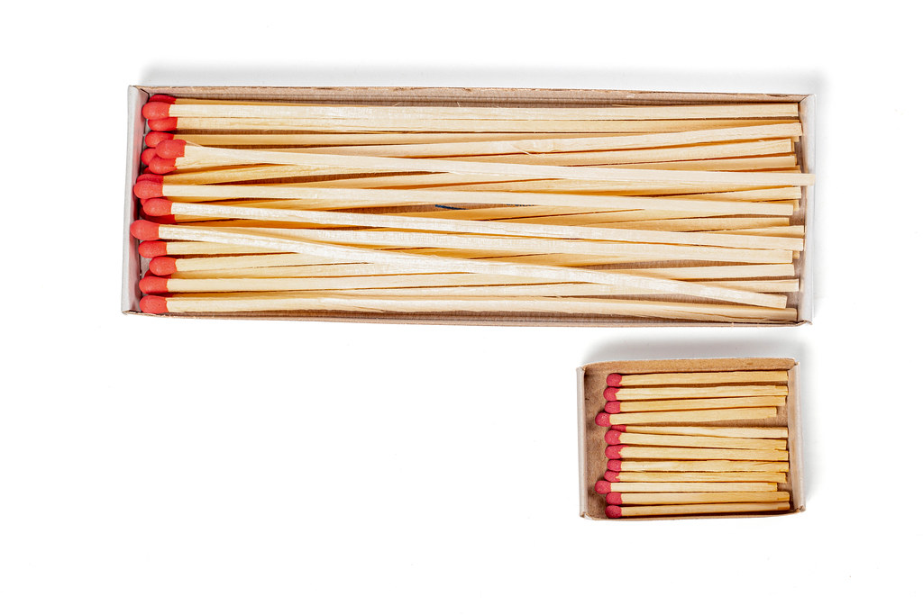 Packages with mantel long and short matches on white, top view