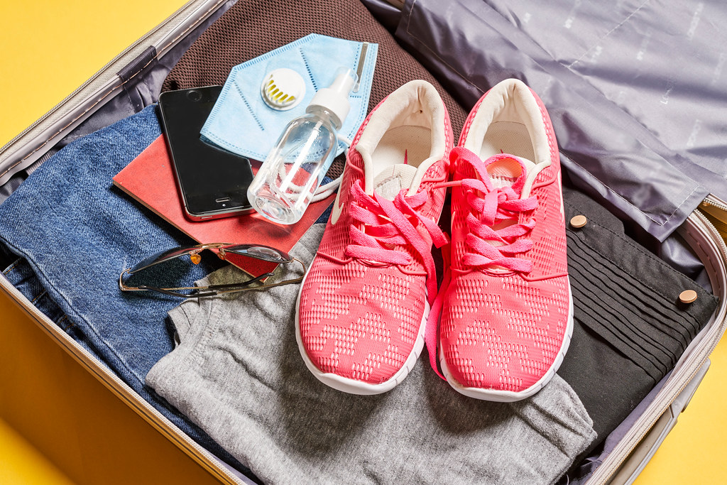 Packed suitcase with travel accessories. Vacation concept