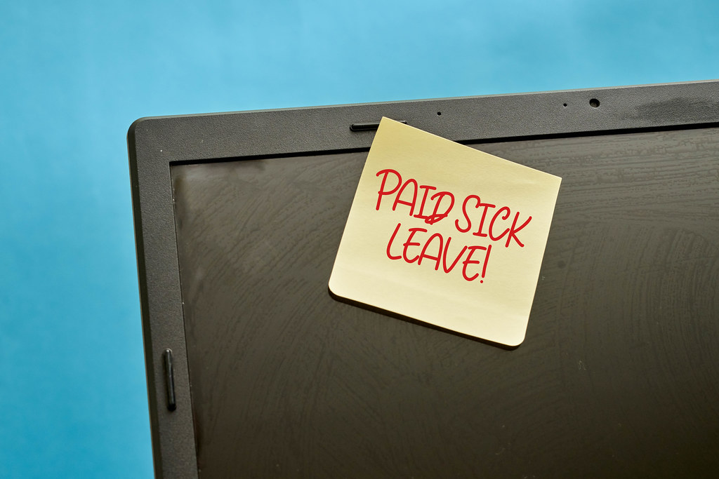 Paid sick leave note on the laptop