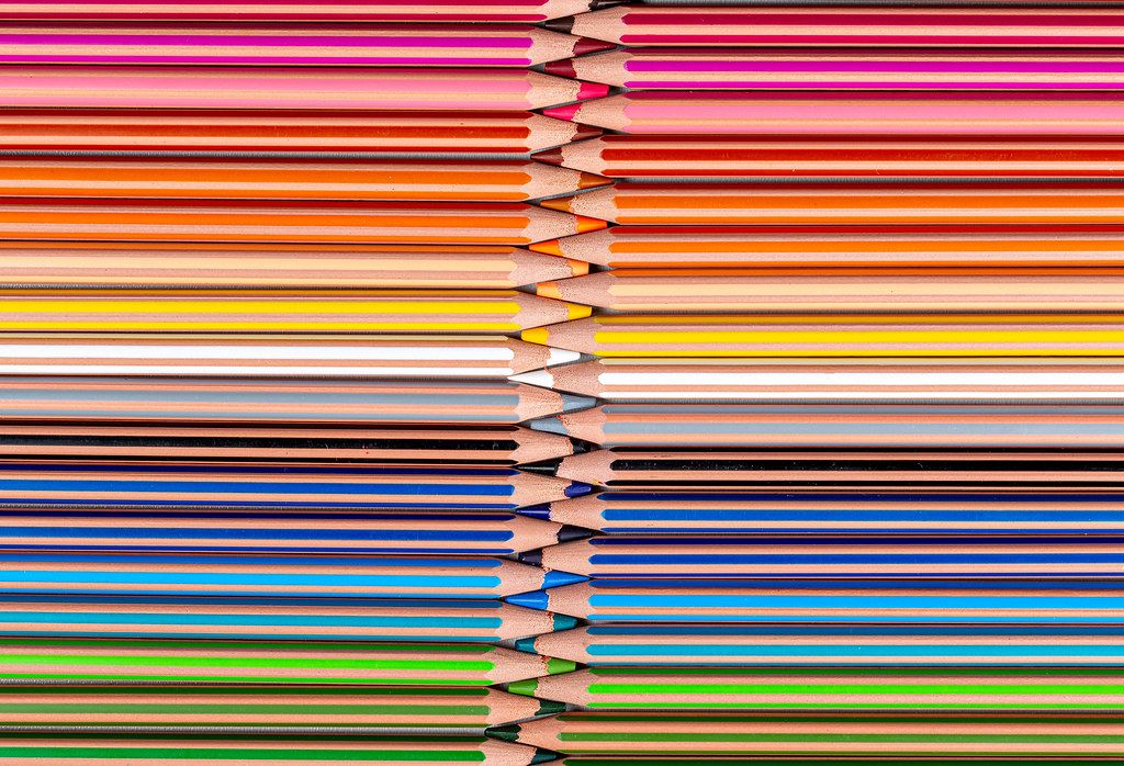 Palette of multi-colored pencils, top view