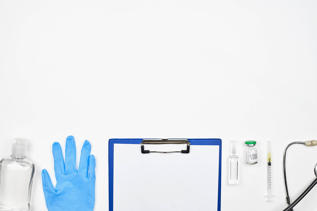 Pandemic times: medical and pharmaceutical equipment on white background with copy space