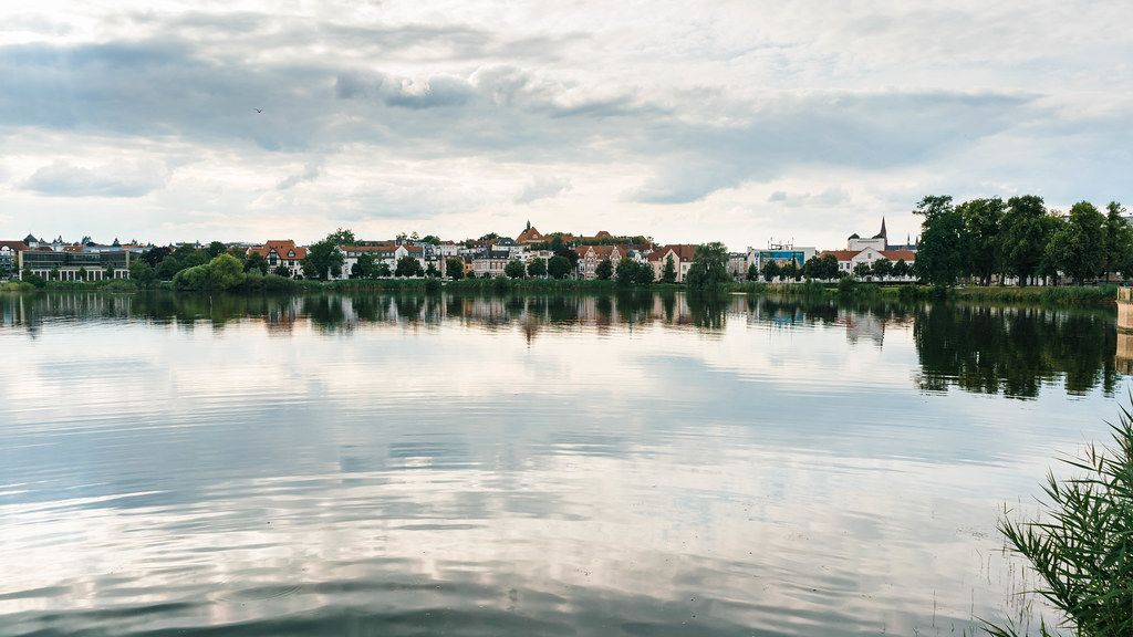 Panorama of beautiful German town Schwerin with reflection in the lake