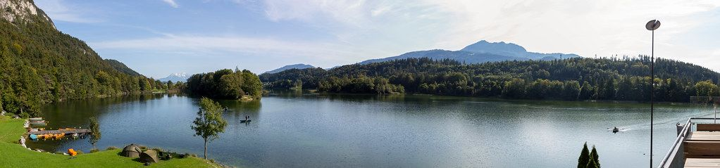 Panoramic shot of natural swimming lake Reintalersee in the Alpbach valley in Tyrol, Austria