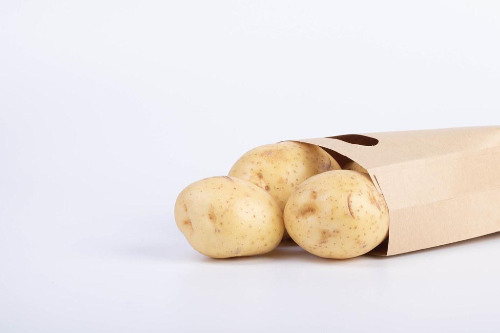 Paper bag full of potatoes