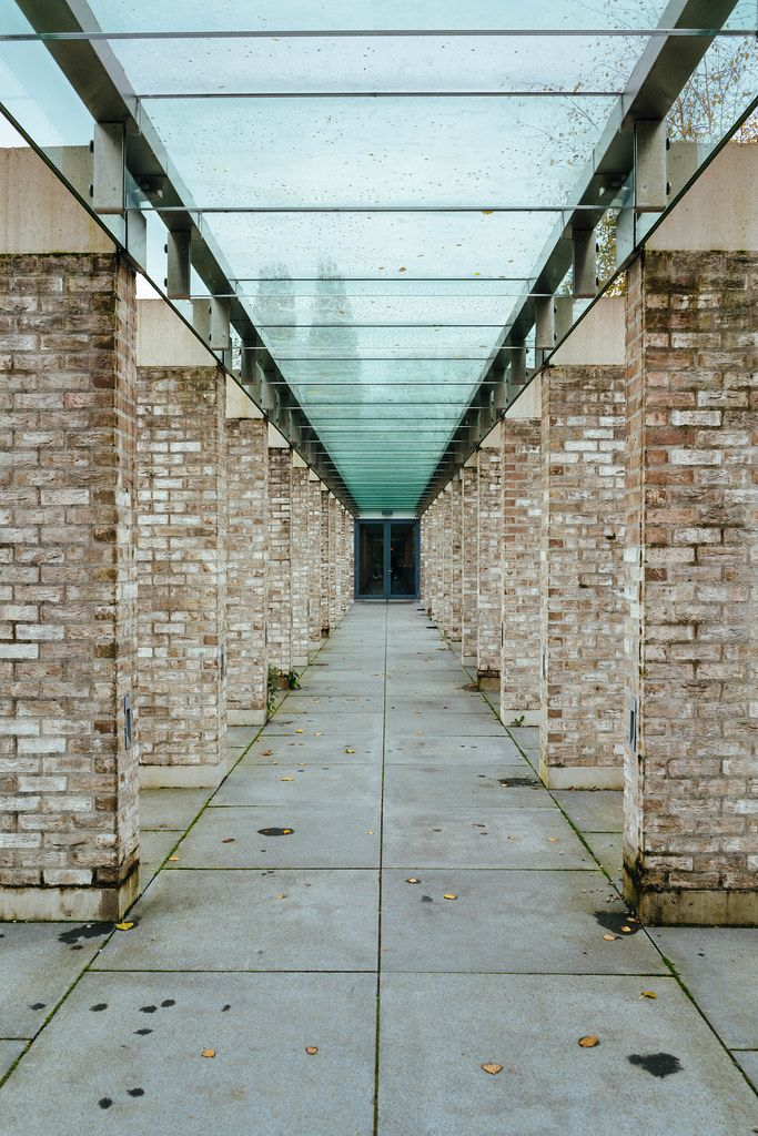 Passage with glass roof and Brik columns at cemetery complex De Nieuwe Noorder in Amsterdam