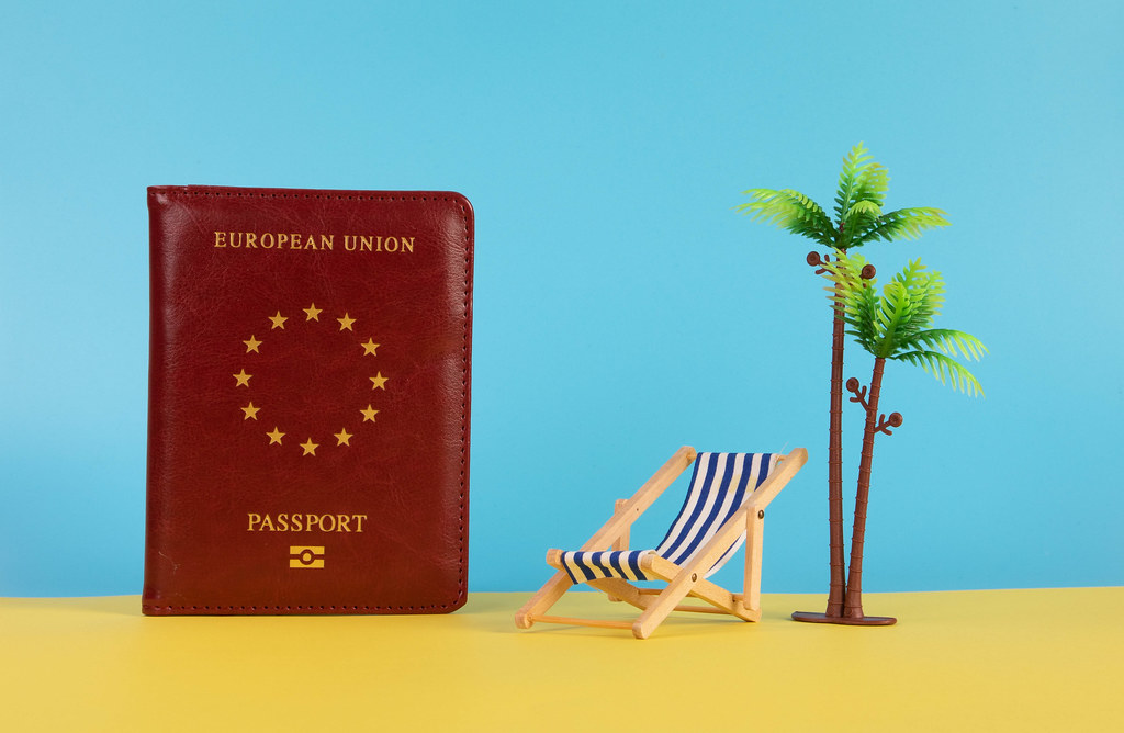 Passport, deck chair, and palm tree