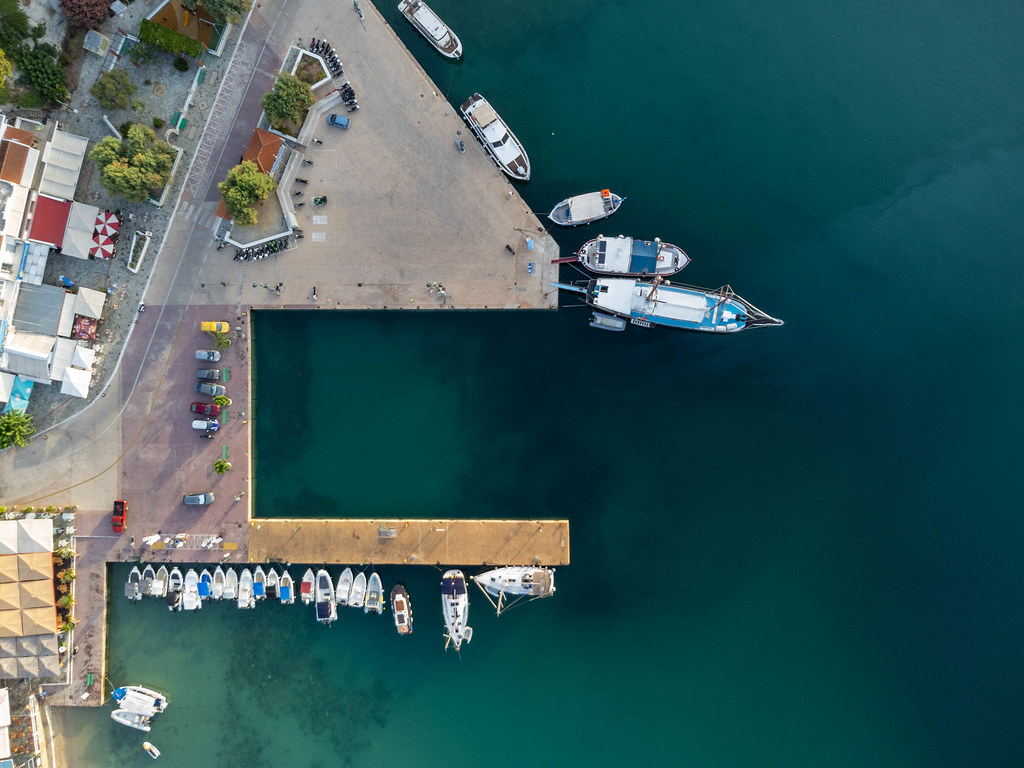 Patitiri Port on Alonnisos: overhead shot of the turquoise waters, boats, pier and parked cars