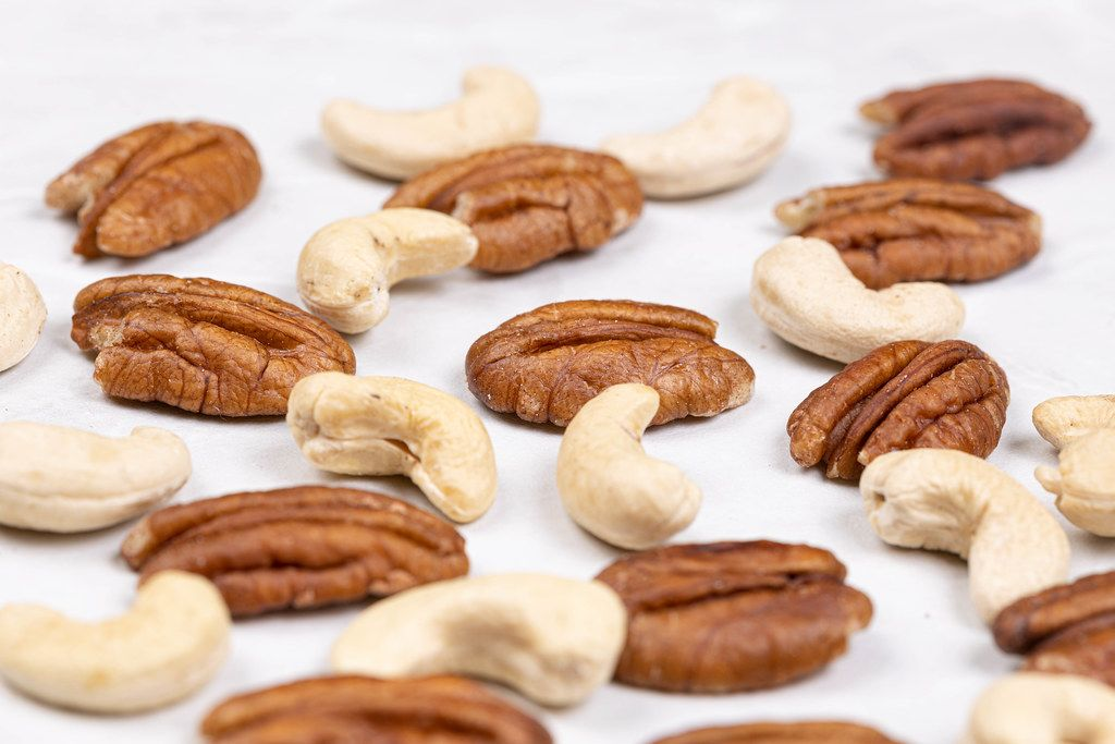 Pecan Nuts and Cashew on the white table
