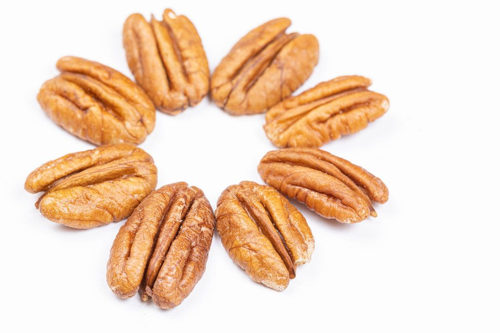 Peckans Nuts arranged on the white background