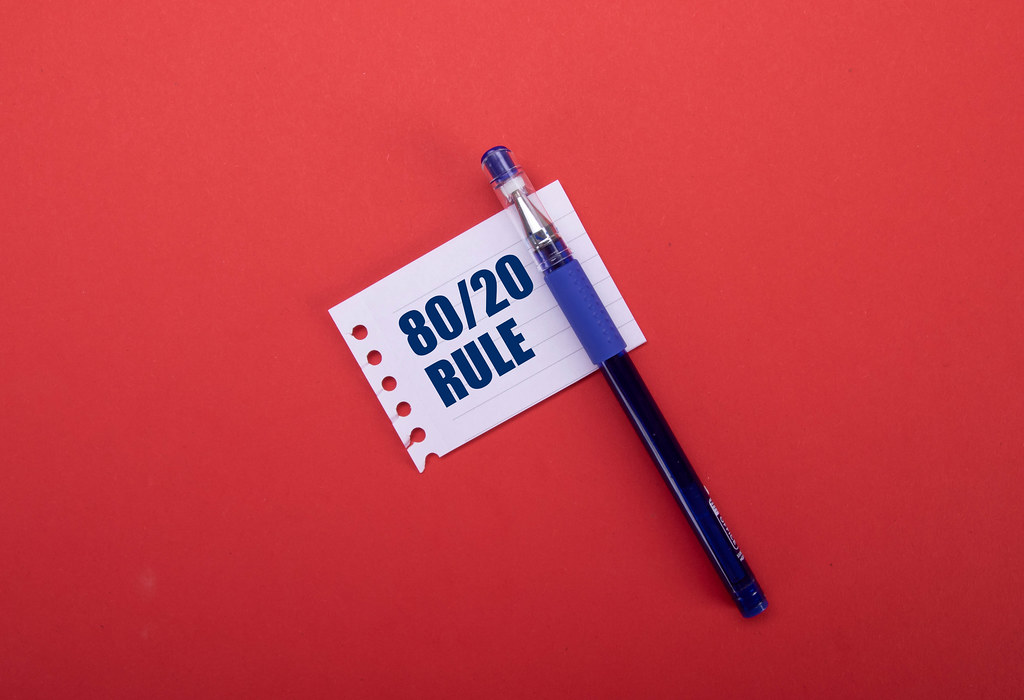 Pen and piece of paper with 80/20 Rule text